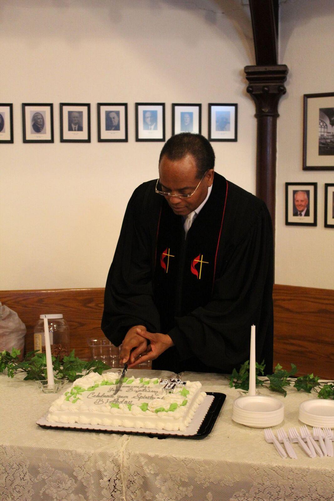 Cutting baptism cake.jpeg