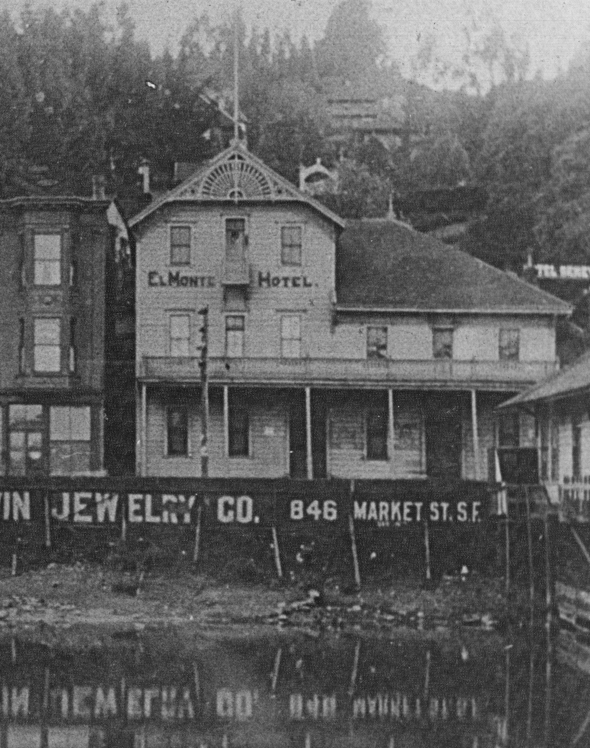 """The El Monte Hotel, c. 1897, above the """"Pond,"""" which is now Vina del Mar Plaza. An advertisement for Baldwin Jewelry in San Francisco hangs below street level"""