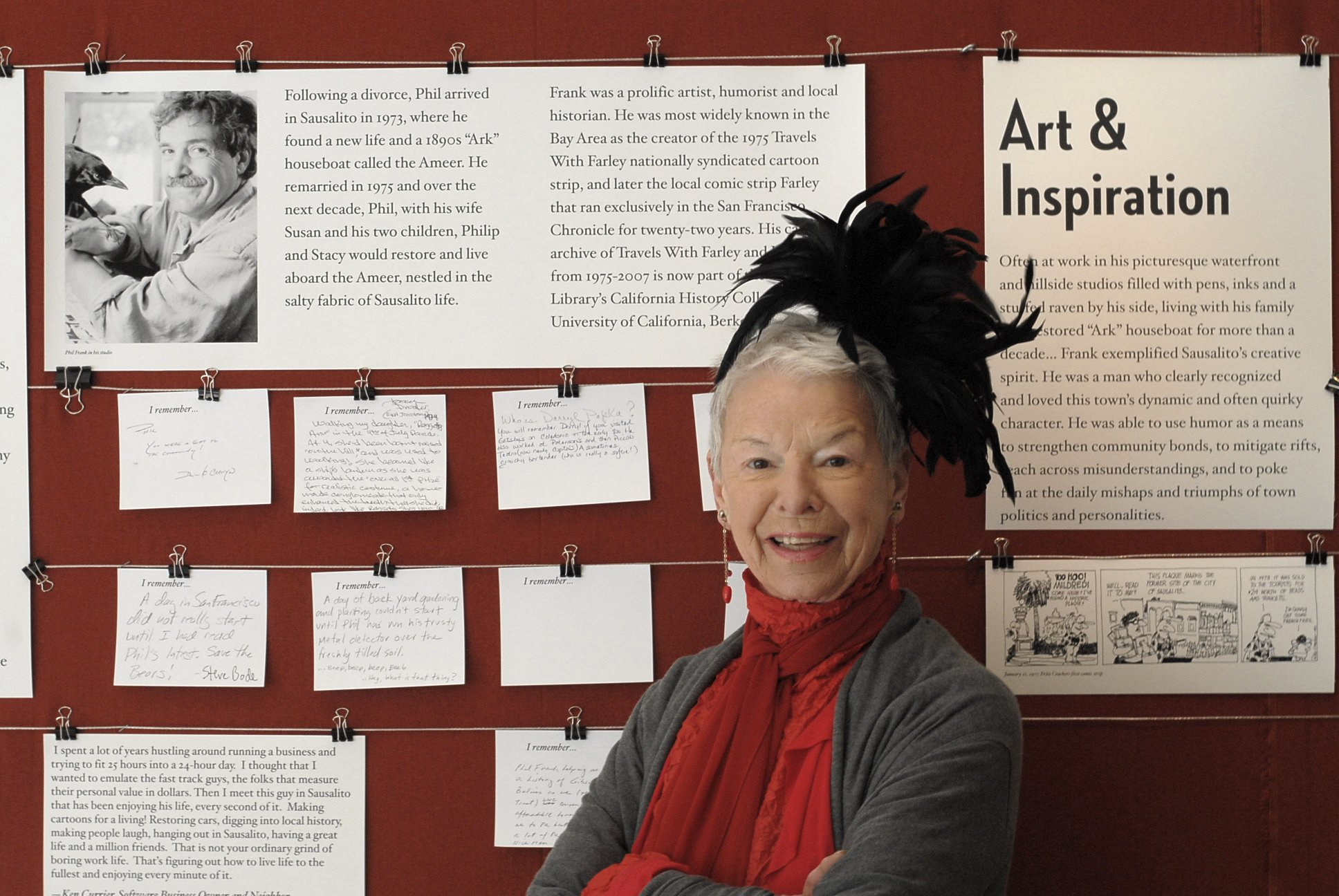 Jeanne Fidler with the display of Phil Frank cartoons at the Historical Society's Exhibit Room. Photo by Steefenie Wicks