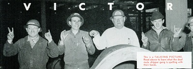 Standing in front of a stern frame, five deaf chippers spell out VICTORY in sign language. Marin-er photo courtesy of Sausalito Historical Society.