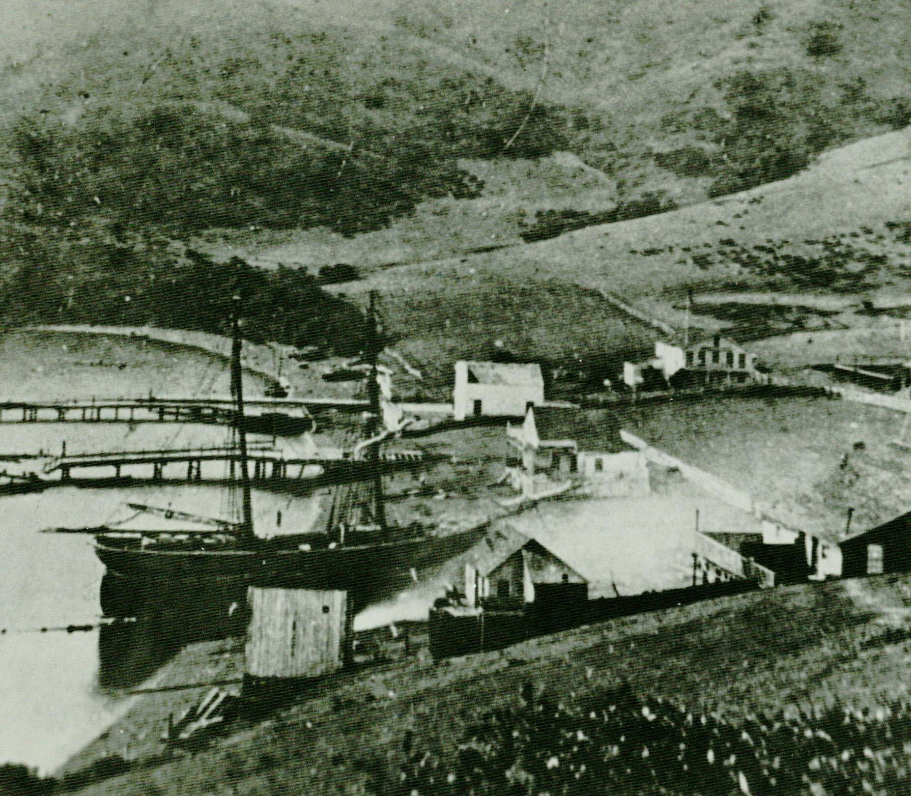 The earliest known photograph of Sausalito, c. 1852, shows Charles Botts's metropolis at its zenith, with perhaps thirty inhabitants. The center of the little cluster of buildings is located where Second and Main are today.   Photo courtesy of Sausalito Historical Society.