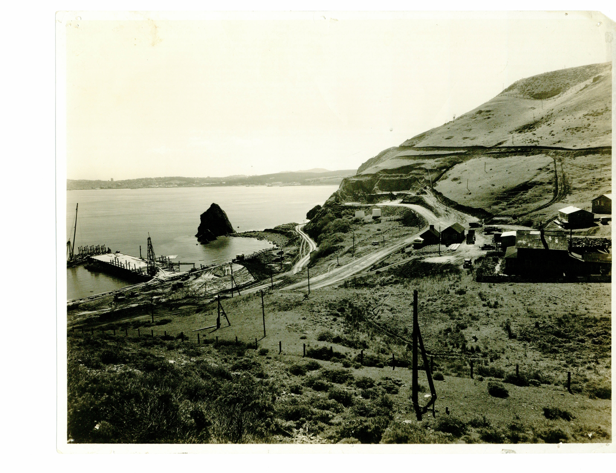 Lime Point in 1933, with Needle Rock to the left, looking across to San Francisco.  Preliminary work has commenced on the Marin anchorage of the Golden Gate Bridge.  Photo courtesy of Sausalito Historical Society.