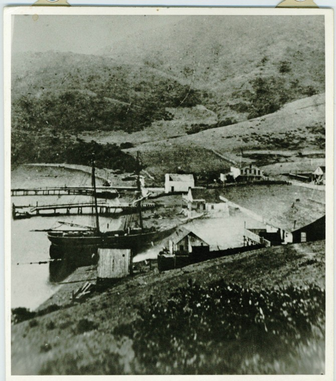 This photo, taken c. 1852, shows rudimentary buildings and piers in Whaler's Cove, now known as Shelter Cove.  Photo Courtesy of Sausalito Historical Society