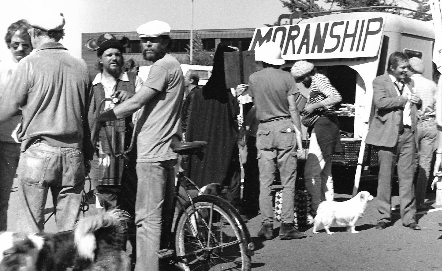 "Chris Hardman (in suit) created a ""Moranship"" poster to demonstrate how Moran wanted to take over Marinship during a protest March in June 1984.            Photo by Steefenie Wicks"