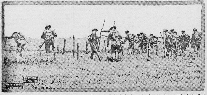 """American troops charging through barbed wire """"in pursuit of the fleeing Huns""""  Photo from Sausalito News"""