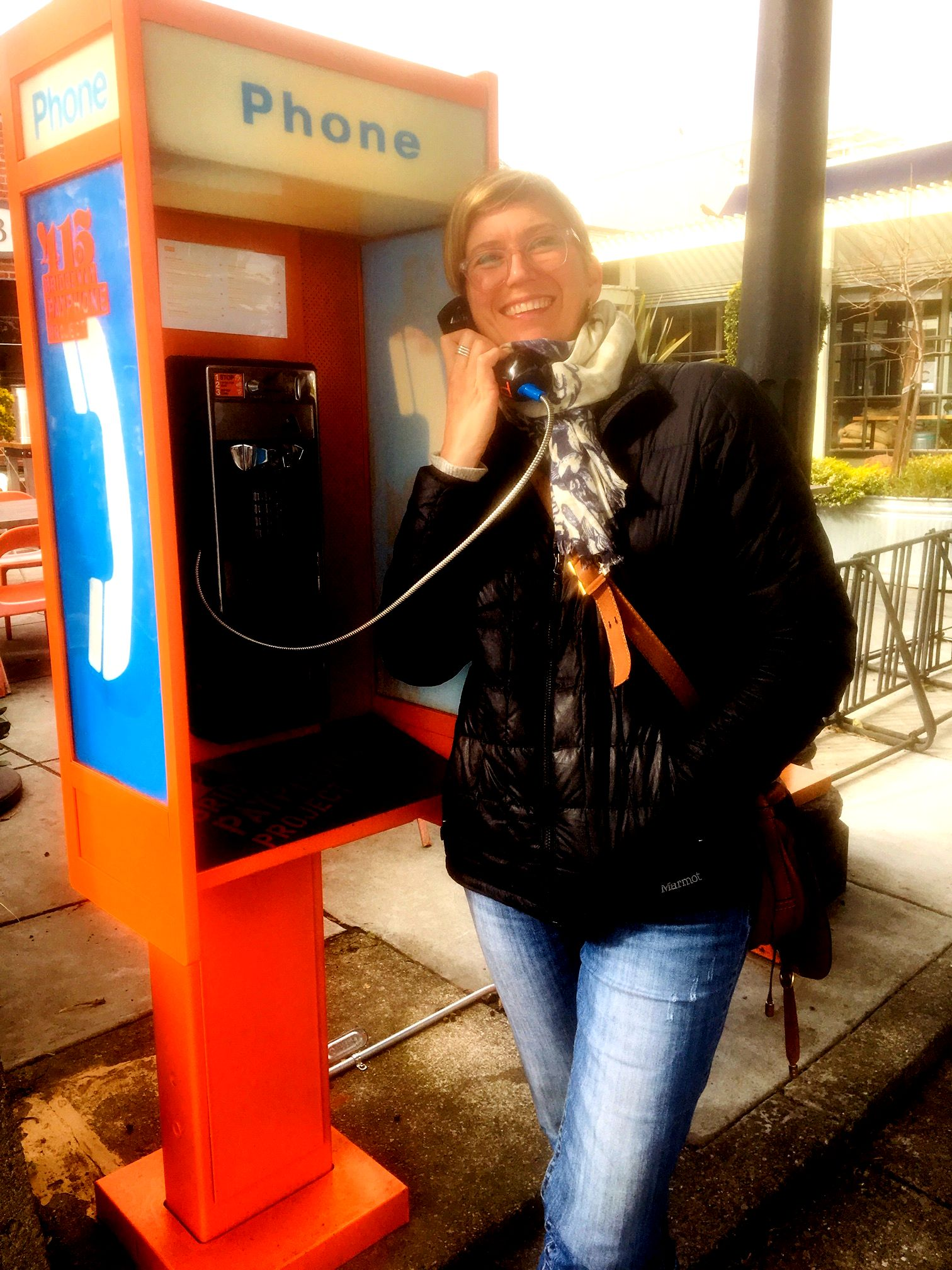 Tera Ancona checks out the payphone recordings outside Cibo.                       Photo by Larry Clinton