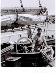 PHOTO COURTESY OF SAUSALITO HISTORICAL SOCIETY  Sterling Hayden's at the helm of Wanderer