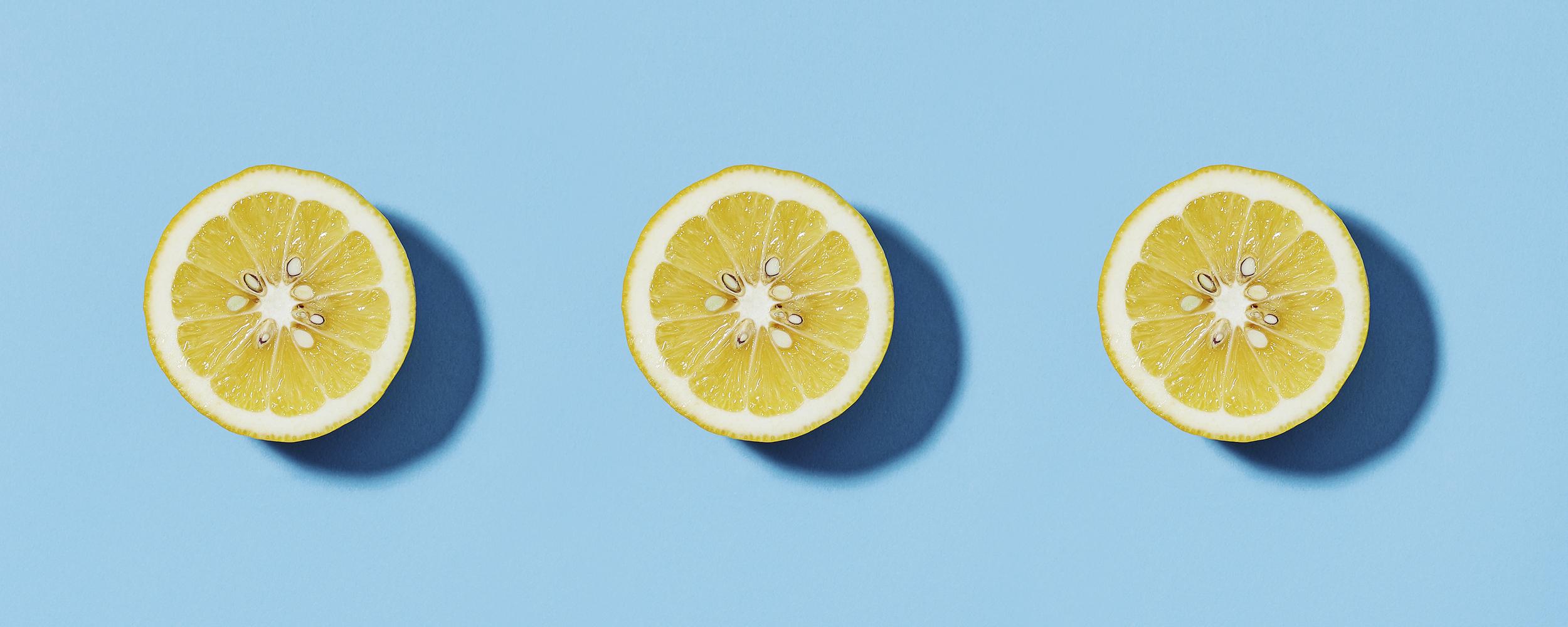 Three lemons on a blue background