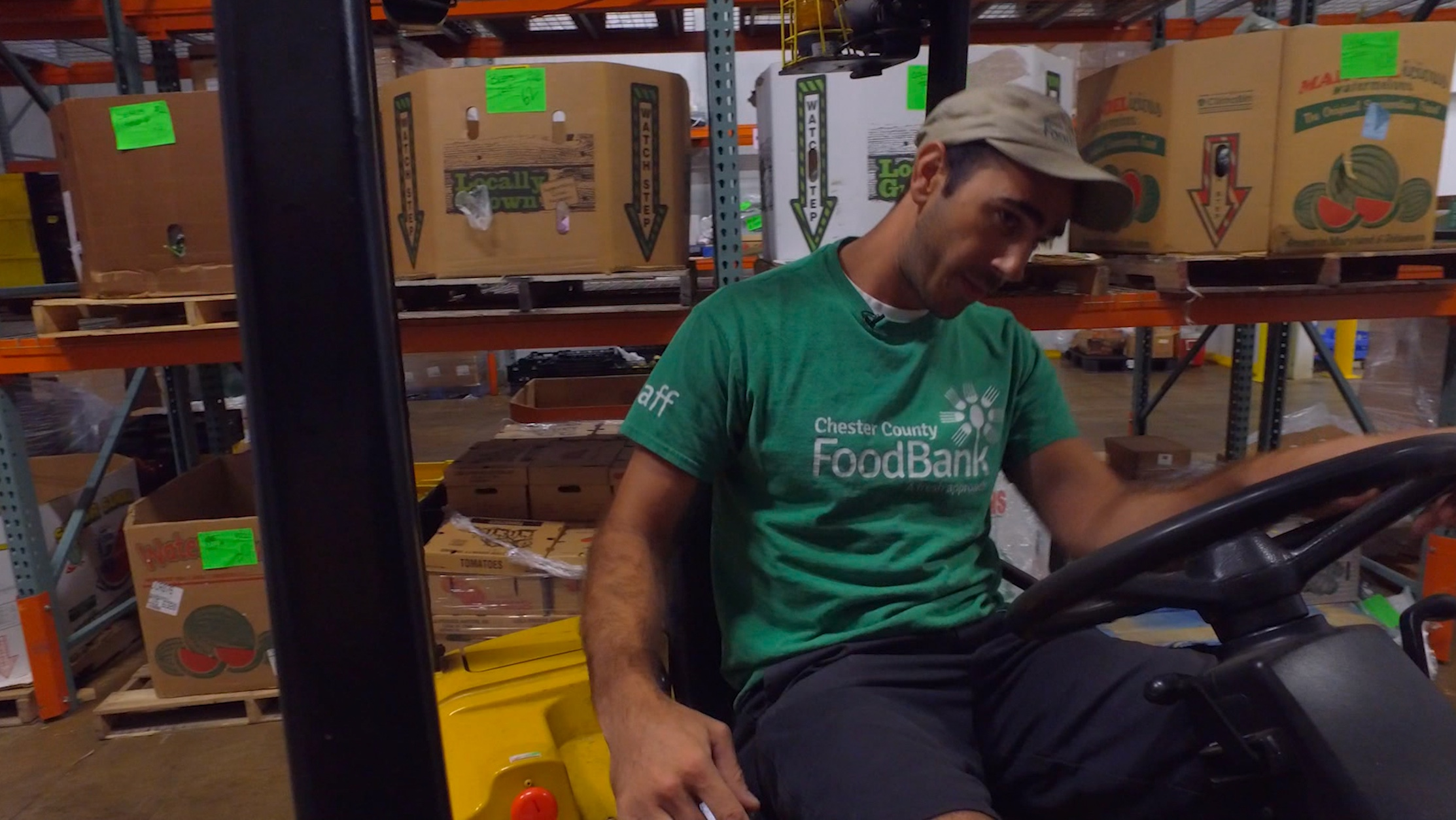 Chester county food bank worker on forklift