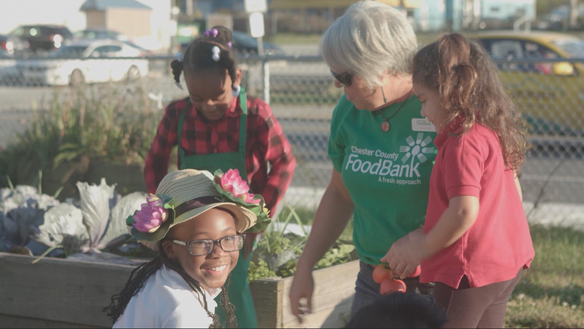 Children learning to make raised bed garden