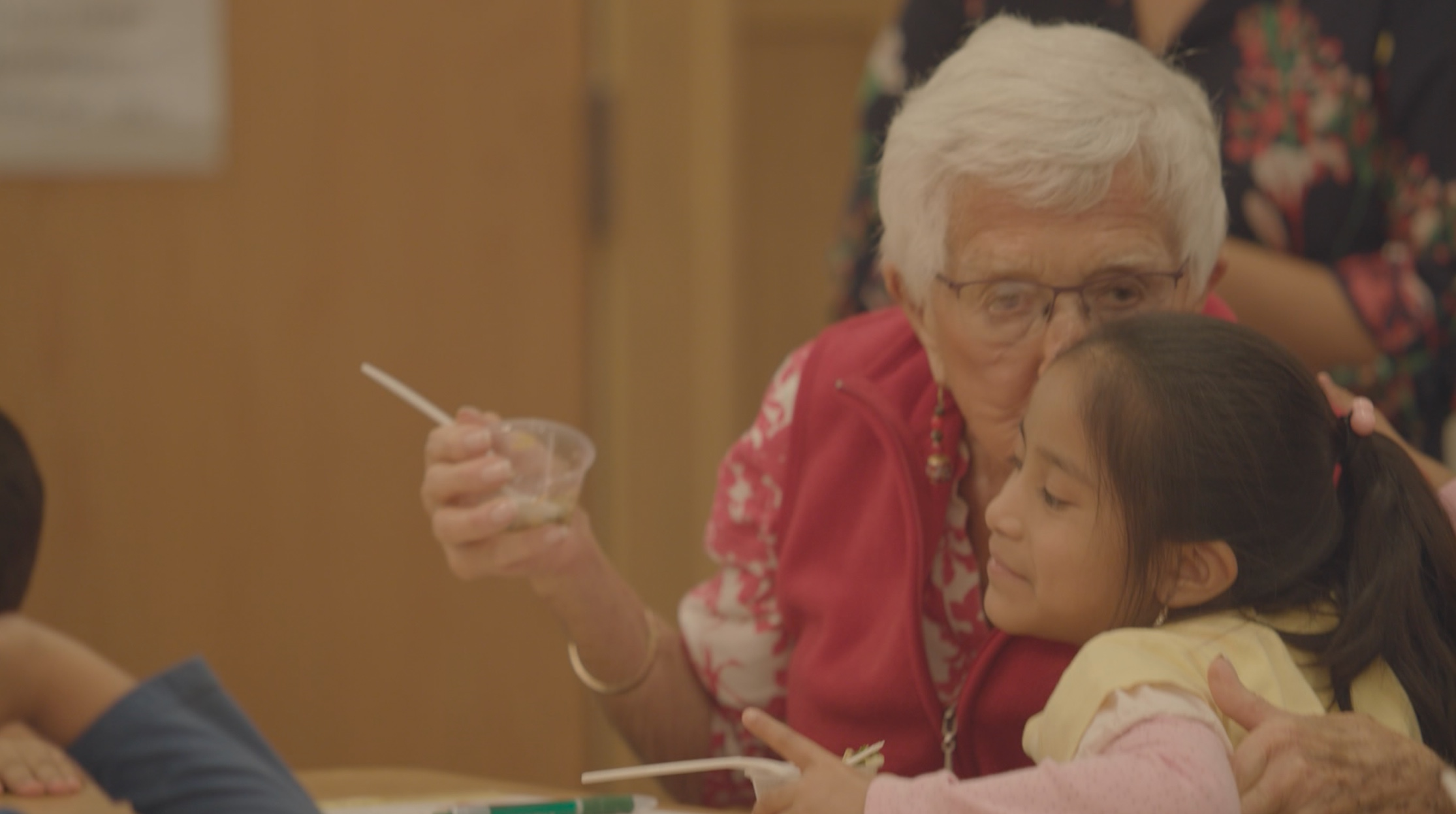 children cooking with seniors