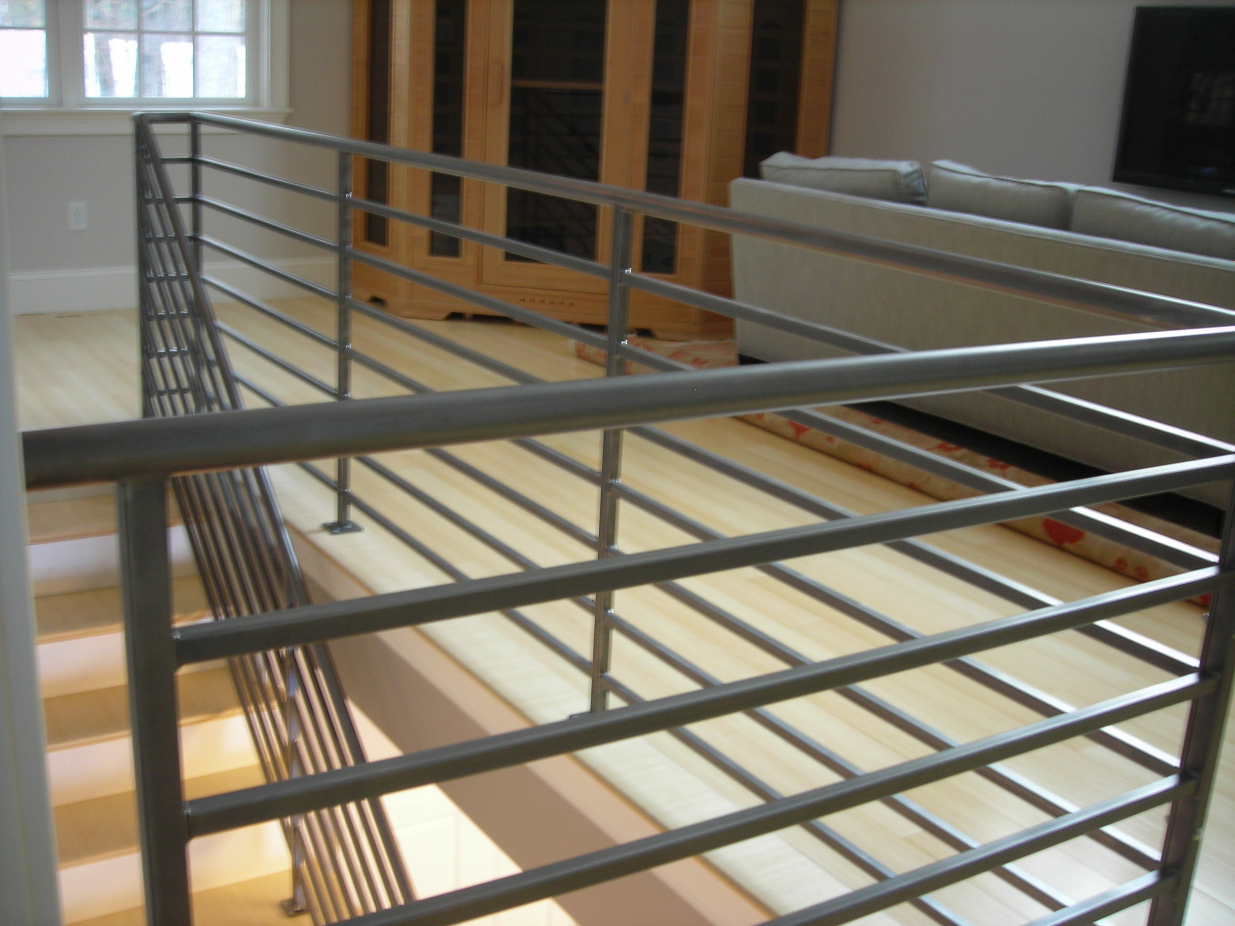 Steel Horizontal Bar Interior Rail. Brush Finish topped with Clear-Coat Finish.