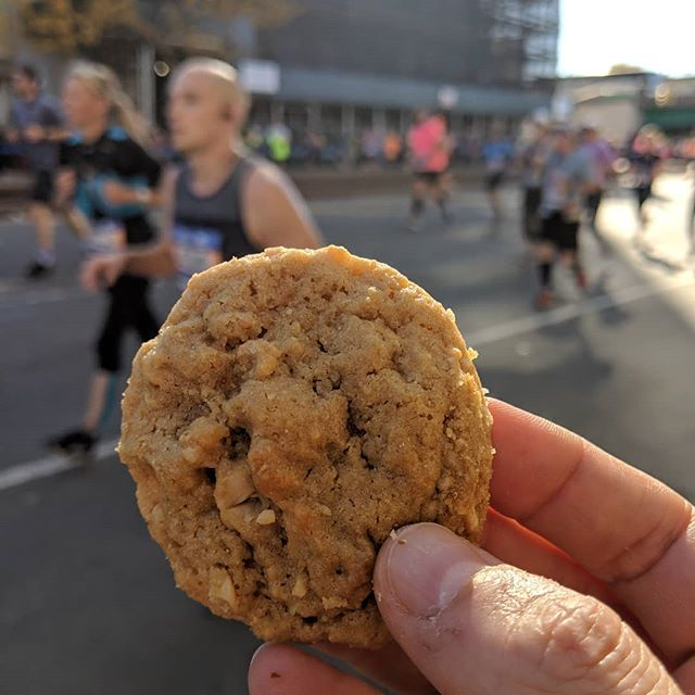 """Well, I missed all of my runners except one but at least I got a shot of the super-chewy, insanely delicious cashew cookies I made. Andy was like, """"You'd better be careful holding that thing out. Someone is going to take it."""" I wish a marathoner had. It would have been a great energy boost for the 20 miles ahead. 🍪 Recipe from The Great Minnesota Cookie Book by @leesdean and @ricknelsonstrib. Photographed by Tom Wallace. #tcsnycmarathon"""