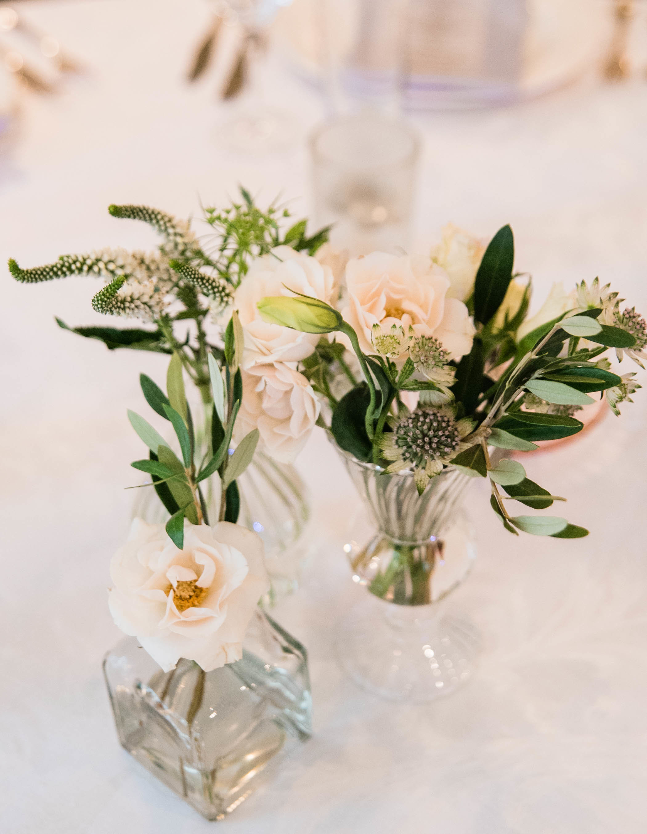 Minimalist bud vase centerpiece of white flowers and greenery by Wild Fleurette, Virginia + destination event florist.jpg