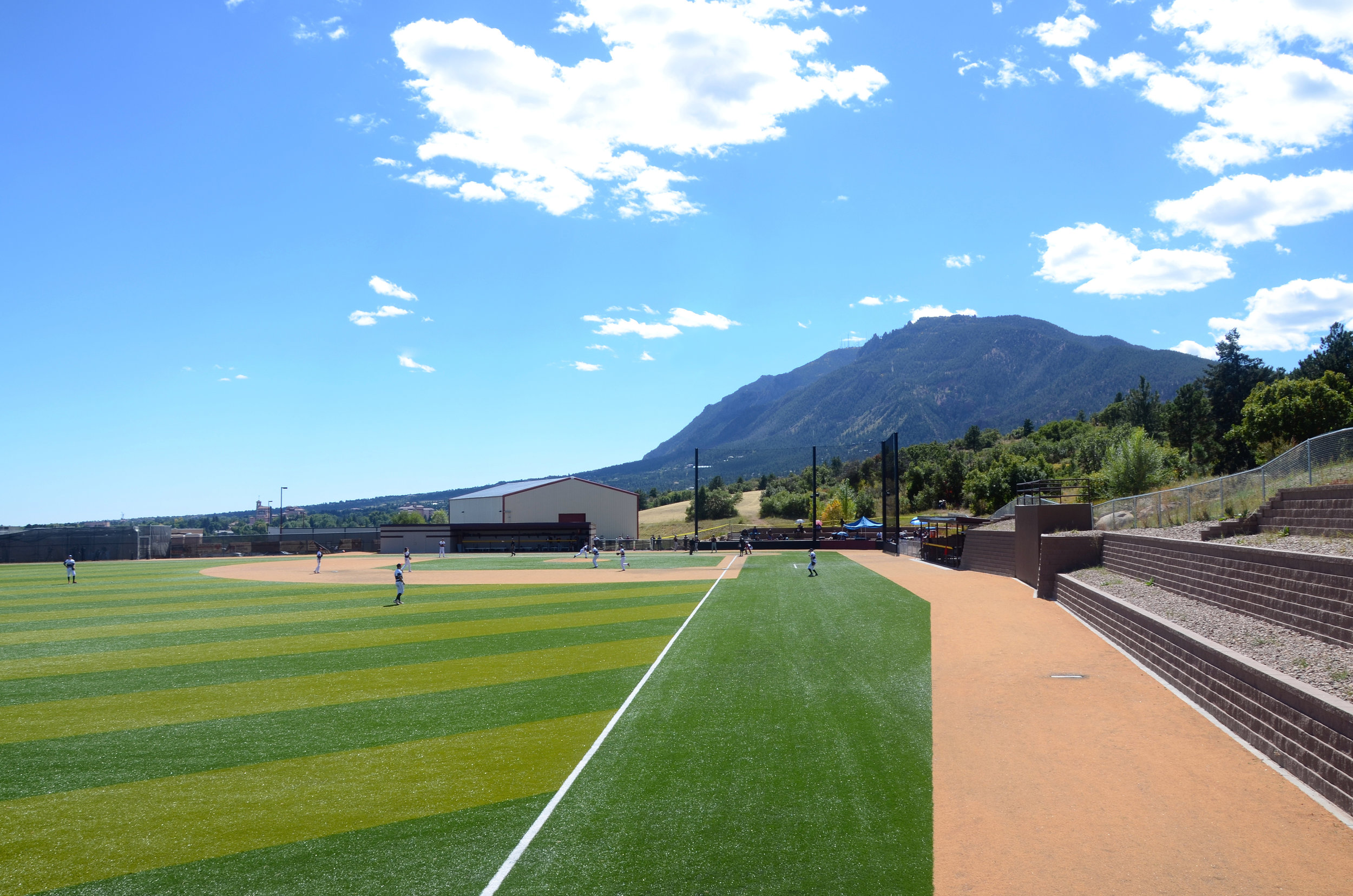 The relocated baseball field now sits on the West slope of the site, creating sweeping views of the city nestled against the stunning mountainside.