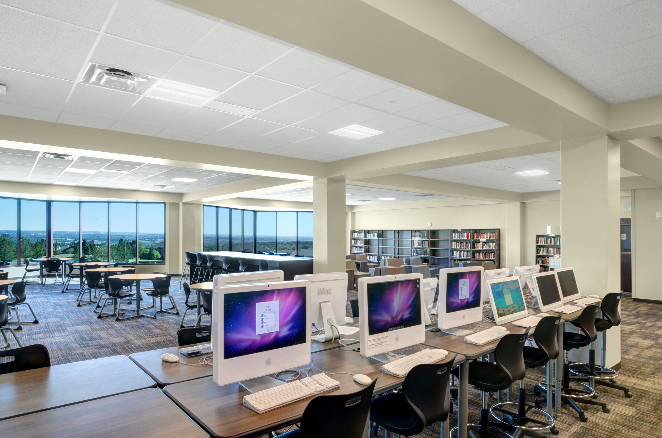 Access to resources, various styles of study furniture and outdoor views make for an ideal library center setting.