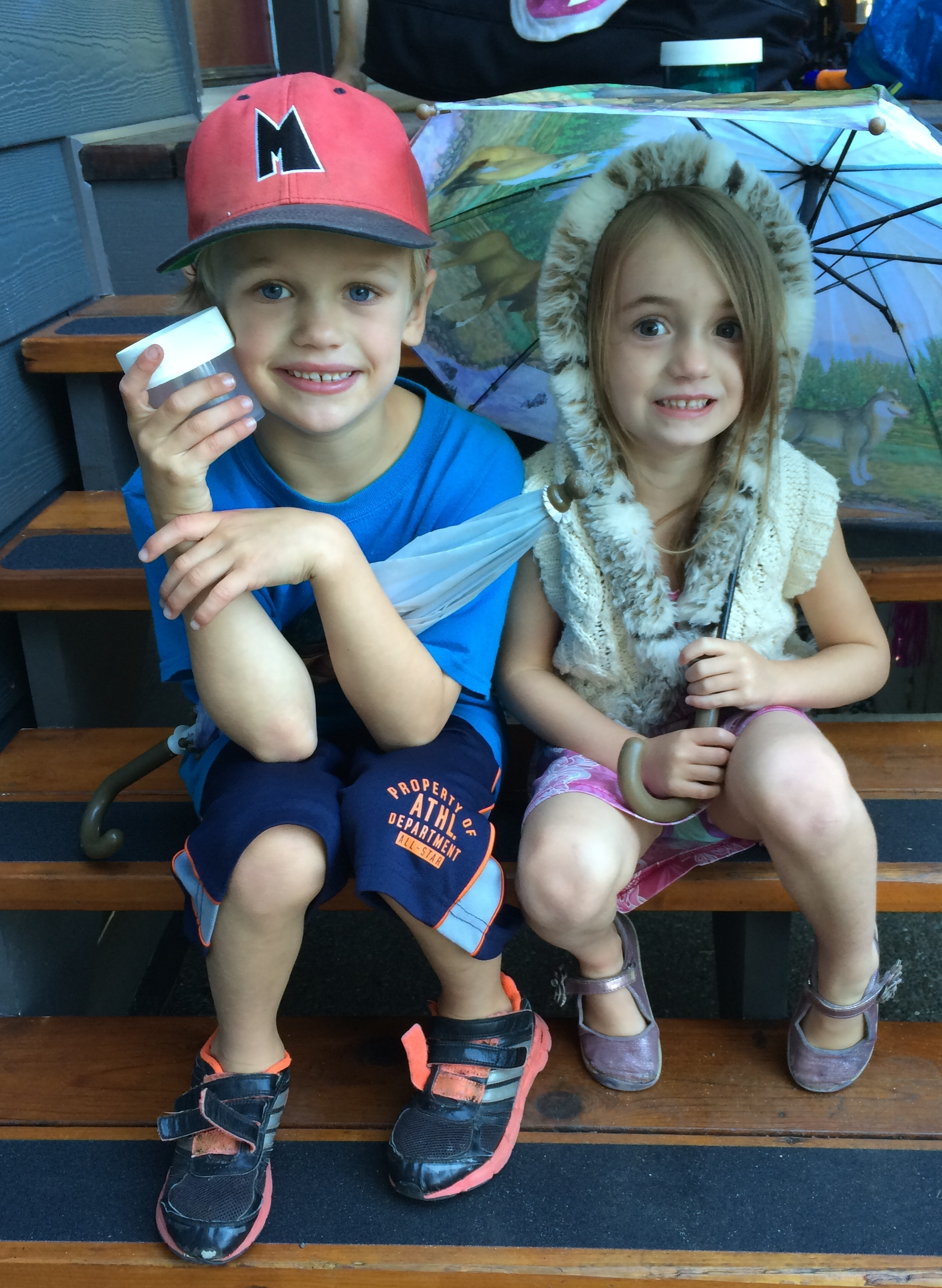"""At this year's AGM, the proud grandparents of Jasper and Claire Bullock presented the association with the """"Toonies for the Loonies"""" the kids had collected from their birthday parties this summer, and wanted to donate to the BRLA to help protect the lake's loons."""