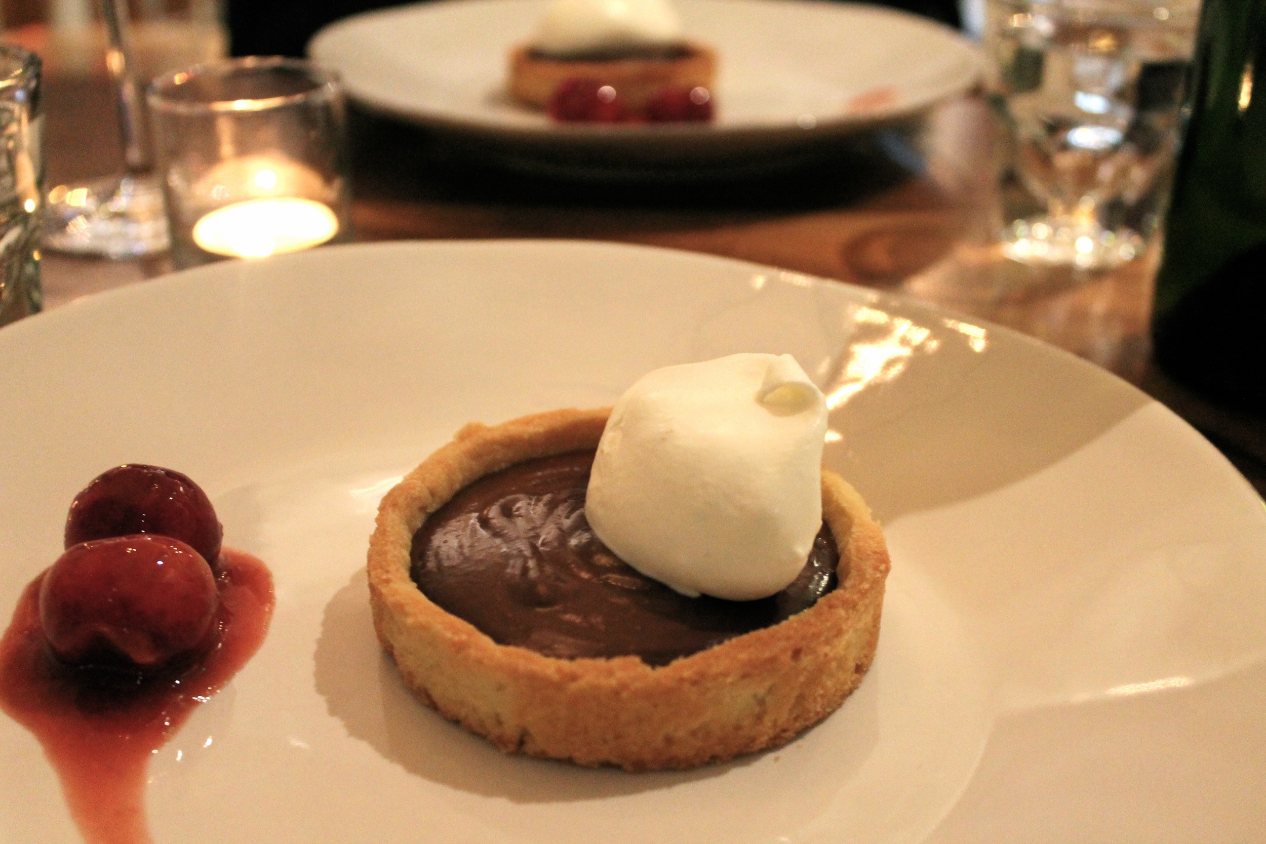 gianduja tart with cherry gastrique