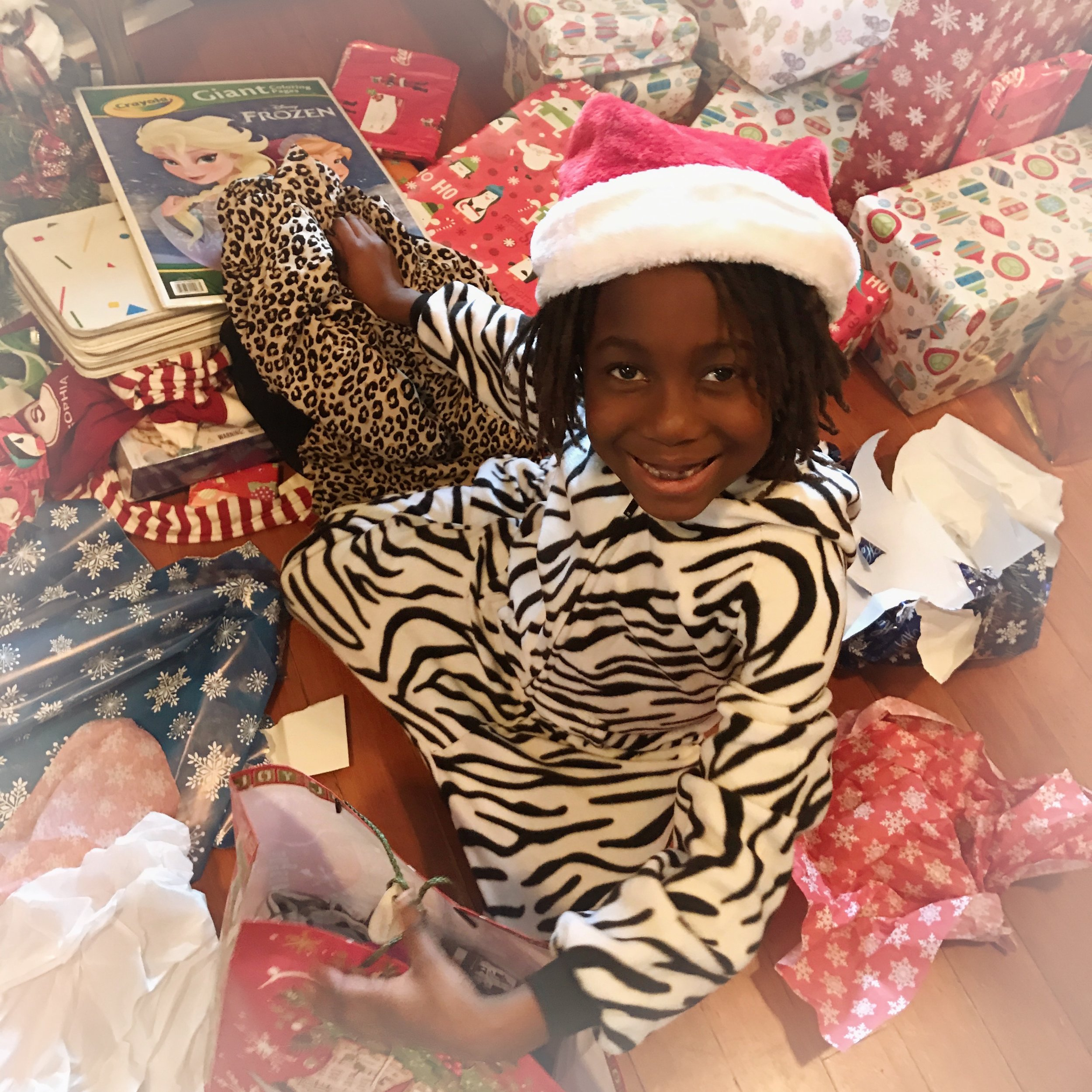 """Junior"" as she now insists on being called, reveling in the glory of Christmas gifts!"