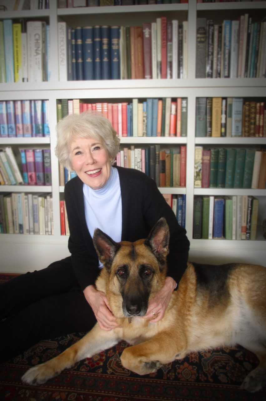 Author, Kristin Von Kreisler with one of her beloved German Shephards.