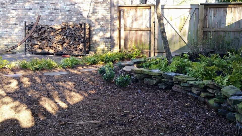 cedar mulch, stacked stone, ferns.jpg