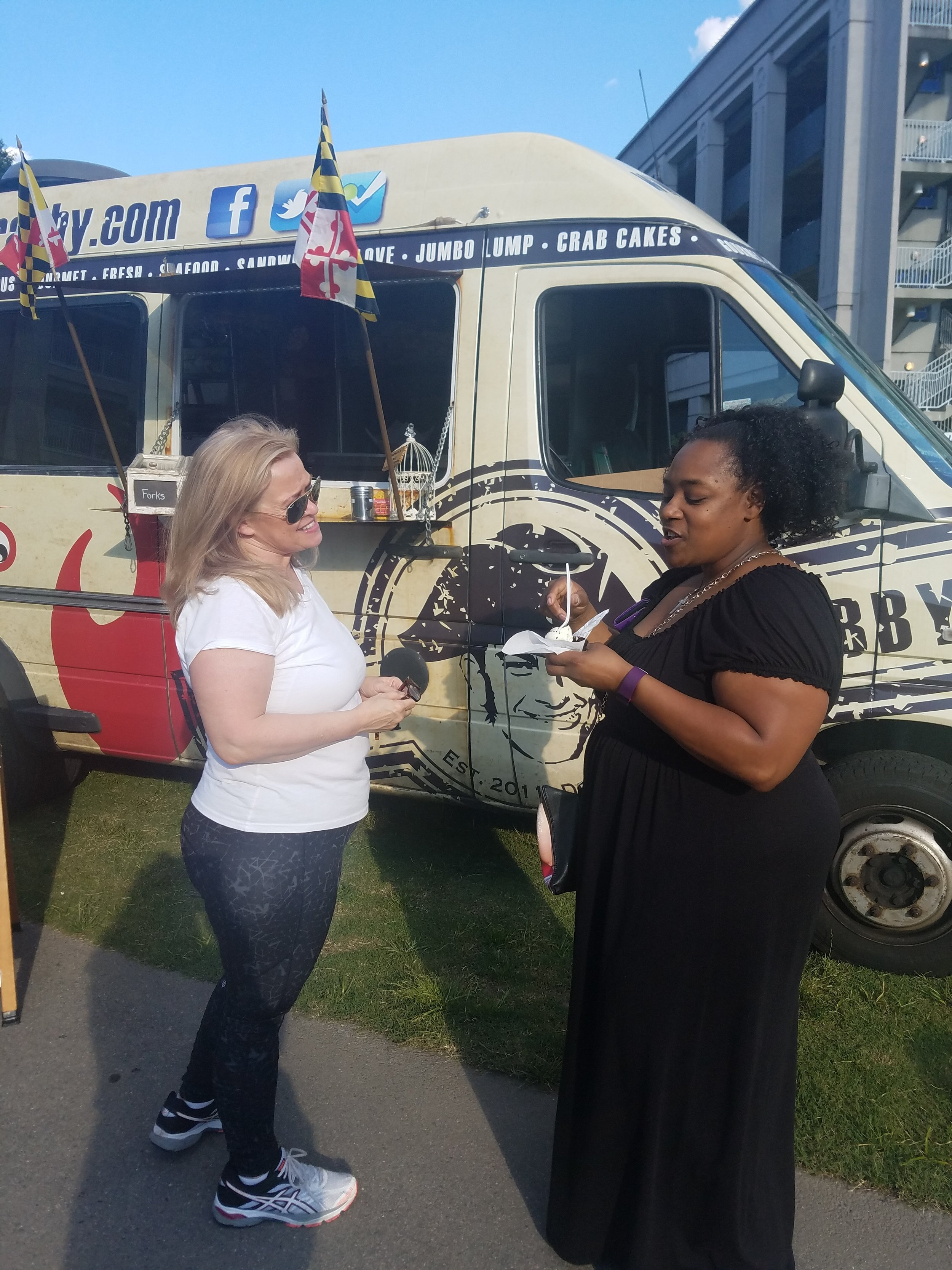 Owner Carla of Just Cupcakes (left) with a customer (right)