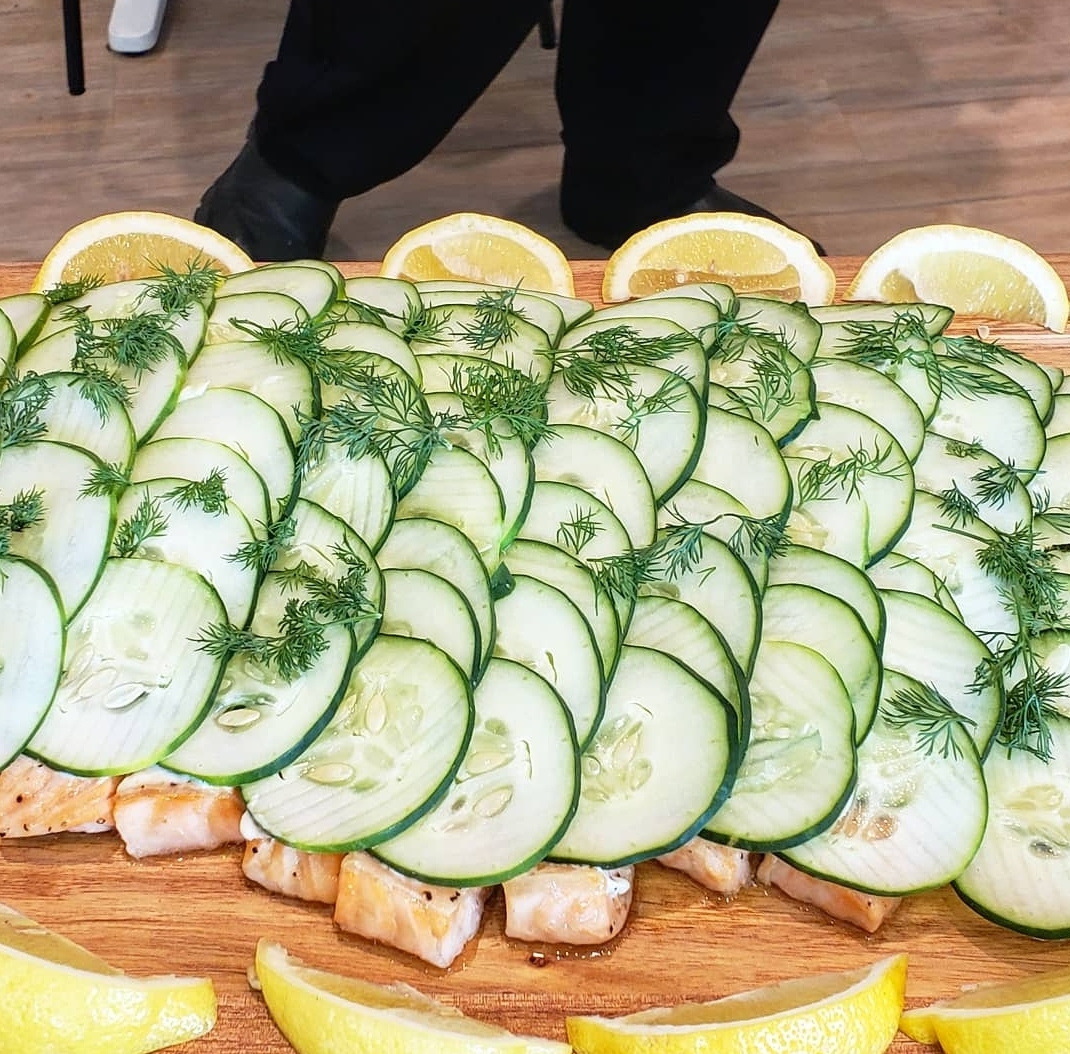 Lax Fillet: Poached salmon and cucumber served with cucumber dill sauce