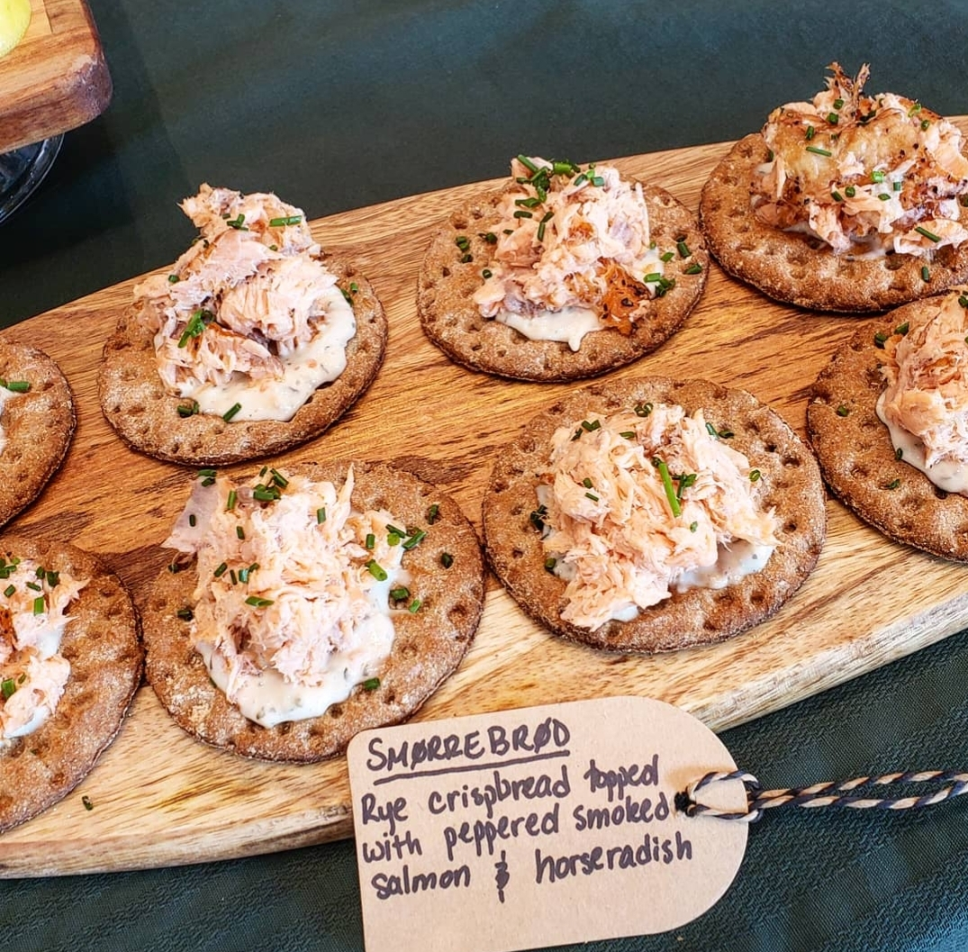 Smorrebrod: Rye crispbread topped with peppered smoked salmon and horseradish