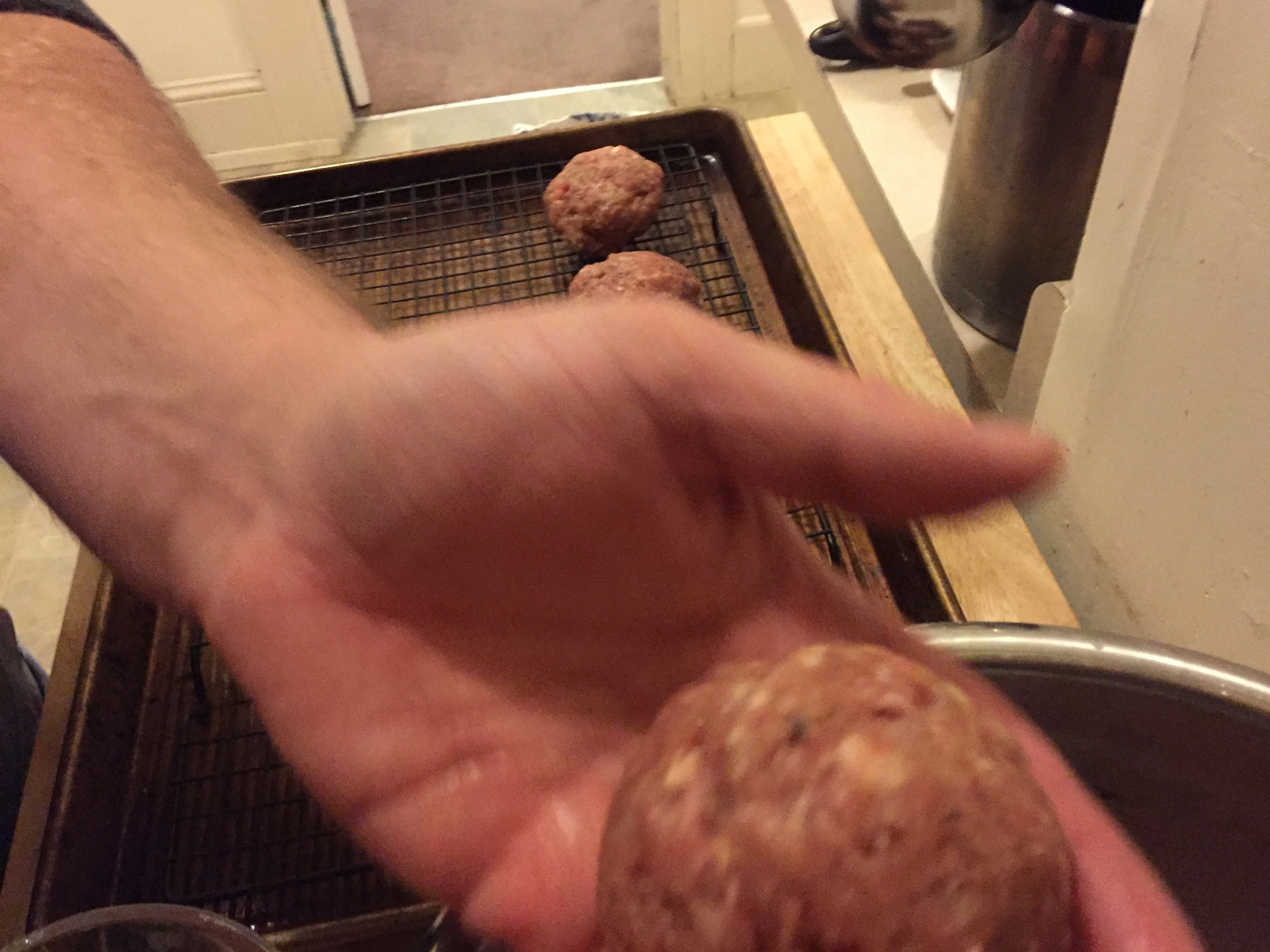 I don't know how this got blurry, but that's more or less what the meatball should look like when you're done rolling it. Minus the blurriness.