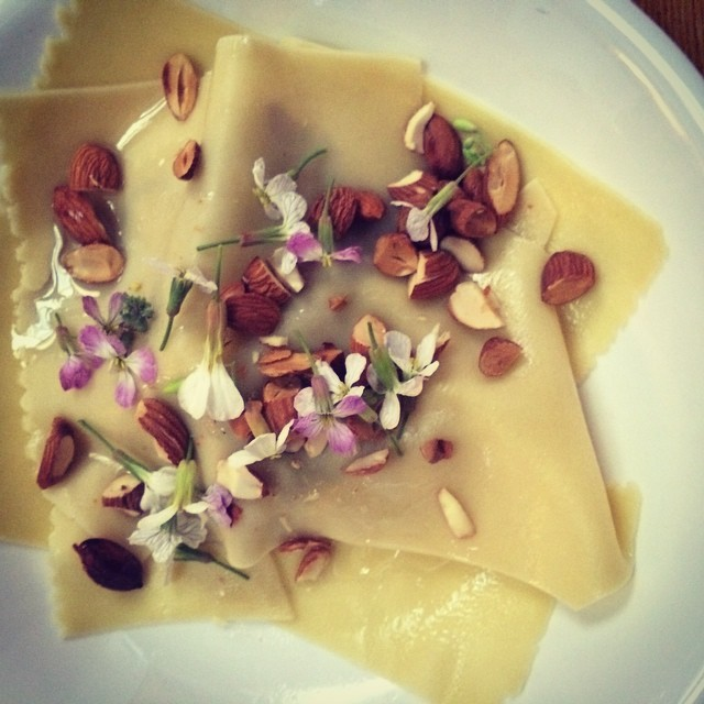 Cygnet oyster mushroom open ravioli with truffle oil and toasted almonds, and jilly's peppery mustard flowers #theriverstable #yukontours #pantreeproduce #thehuonriver #duckeggpasta #discovertasmania (at Huon Valley)