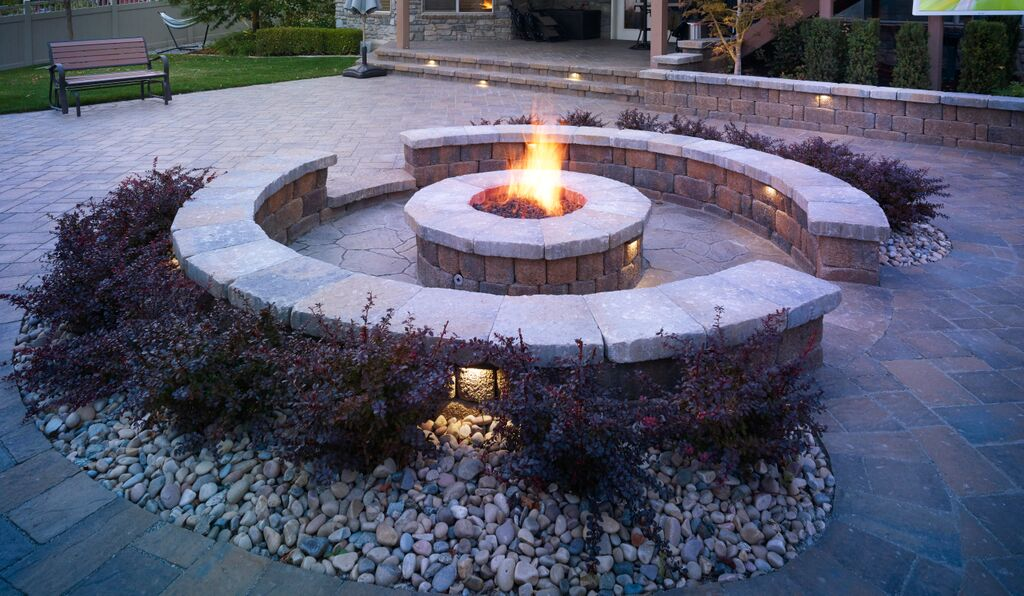 Circular fire pit and seat wall.