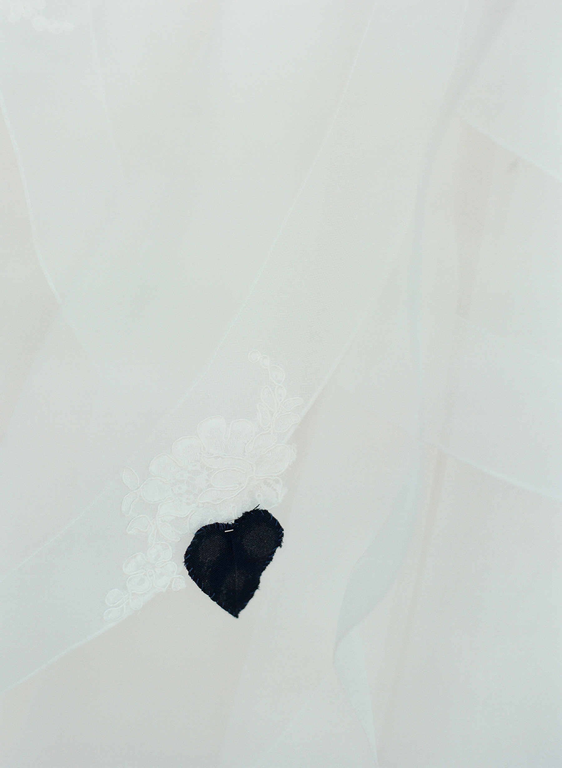 Mother of the Bride sewed a heart inside the bride's gown  made from her and Emily's Dad's officer uniforms.