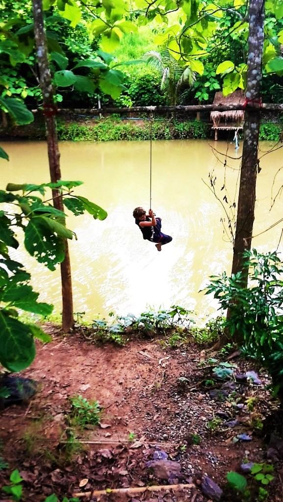 Thomas-swinging-over-the-pond.jpg