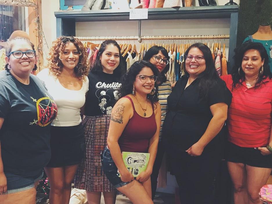 From Left: Isabel Ann Castro of St. Sucia, Eugenia Nicole, Yeiry Guevara, Alma Rosa Rivera, Xitlalic Guijosa, Rebecca Gonzales. First Row: Natasha Hernandez of St. Sucia