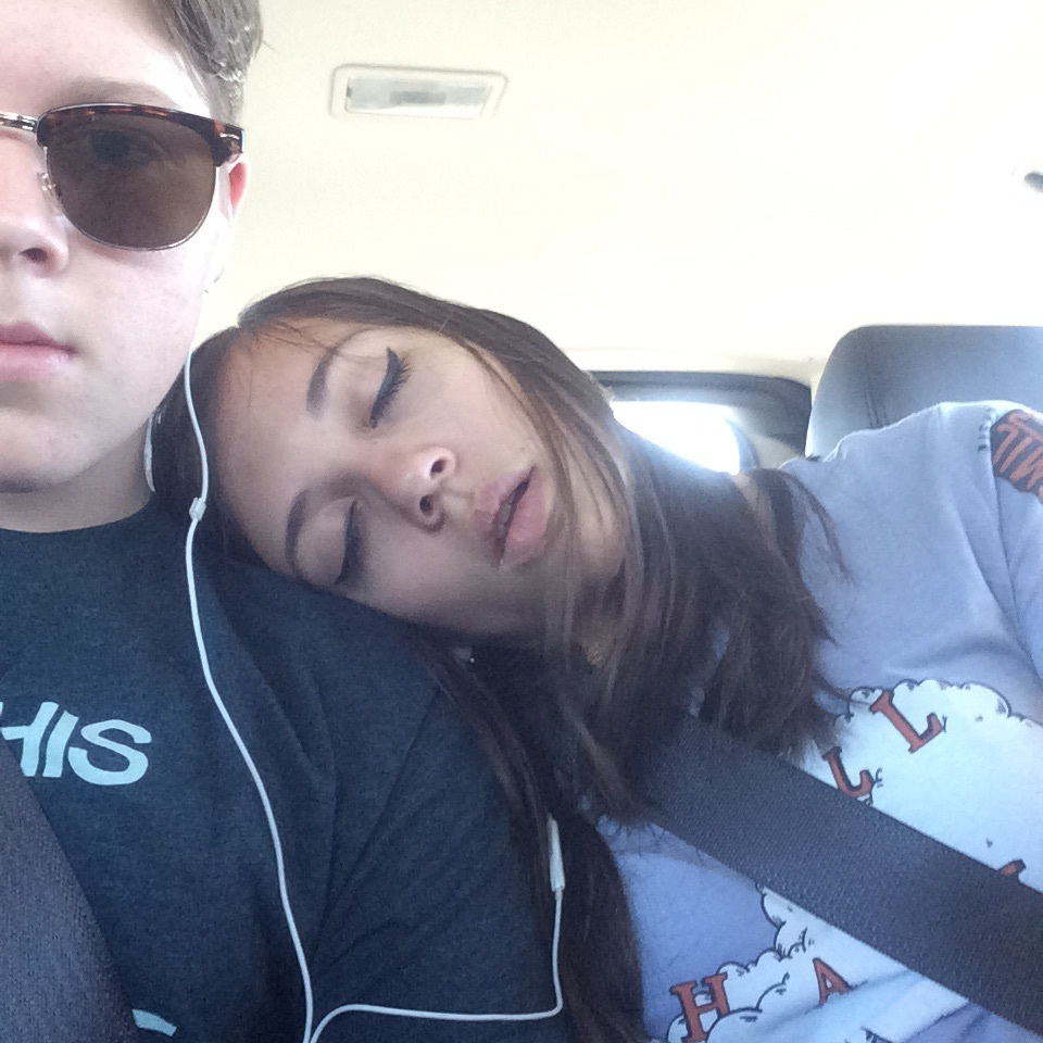 Ana asleep on my shoulder. The earbuds are probably producing the sound of Harry and the Potters.