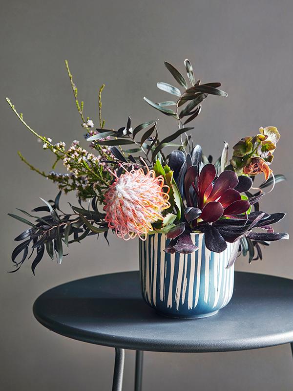 Flora Grubb Gardens Protea and Succulent Flower Arrangement.png