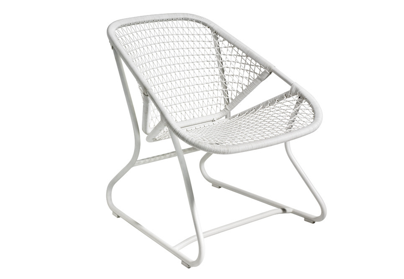 Flora Grubb Gardens White Sixties Chair by Fermob.png