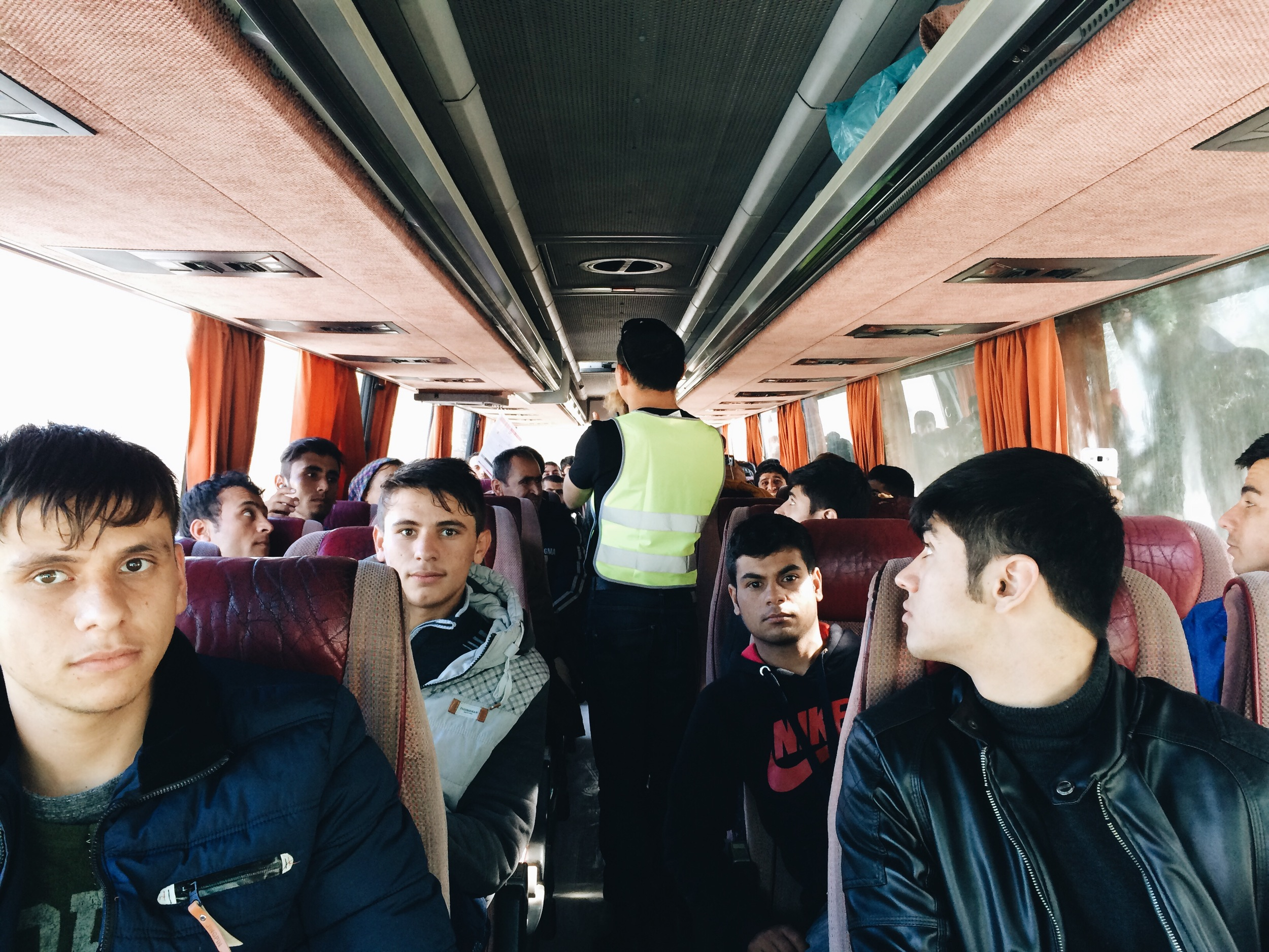 Receiving instructions on the bus to Moria Camp