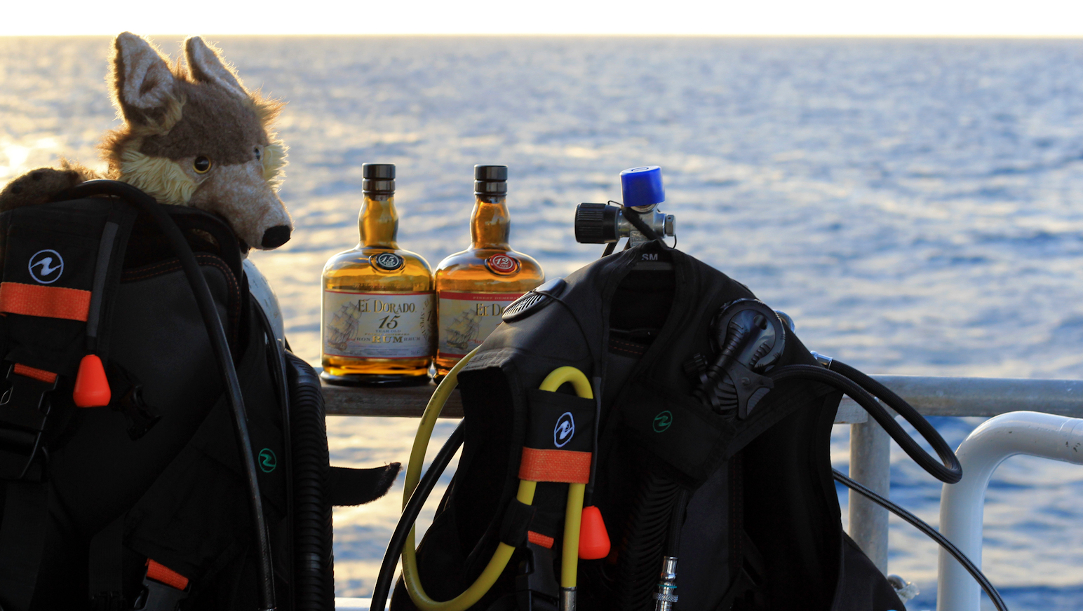 Hitch readies dive gear in case of rum overboard.