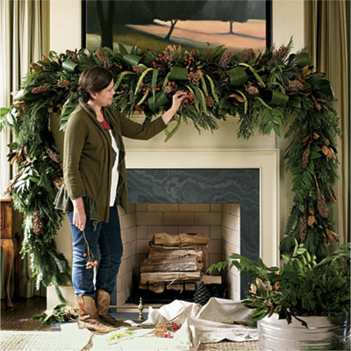 I love this mantle idea SO much I used it as my inspiration for my Christmas mantle last year. This wasn't nearly as difficult as it looks to do! I used fresh garland (the cheap stuff from Home Depot)and intertwined it with fresh magnolia leaves. Then I added large sugar pine cones, fresh winterberry and some dried floral until it felt done! I love the way it looked and felt great that I did it pretty economically (under $100). The BEST part is that the magnolia (the expensive part) dried beautifully and I'll re-use that again this year!