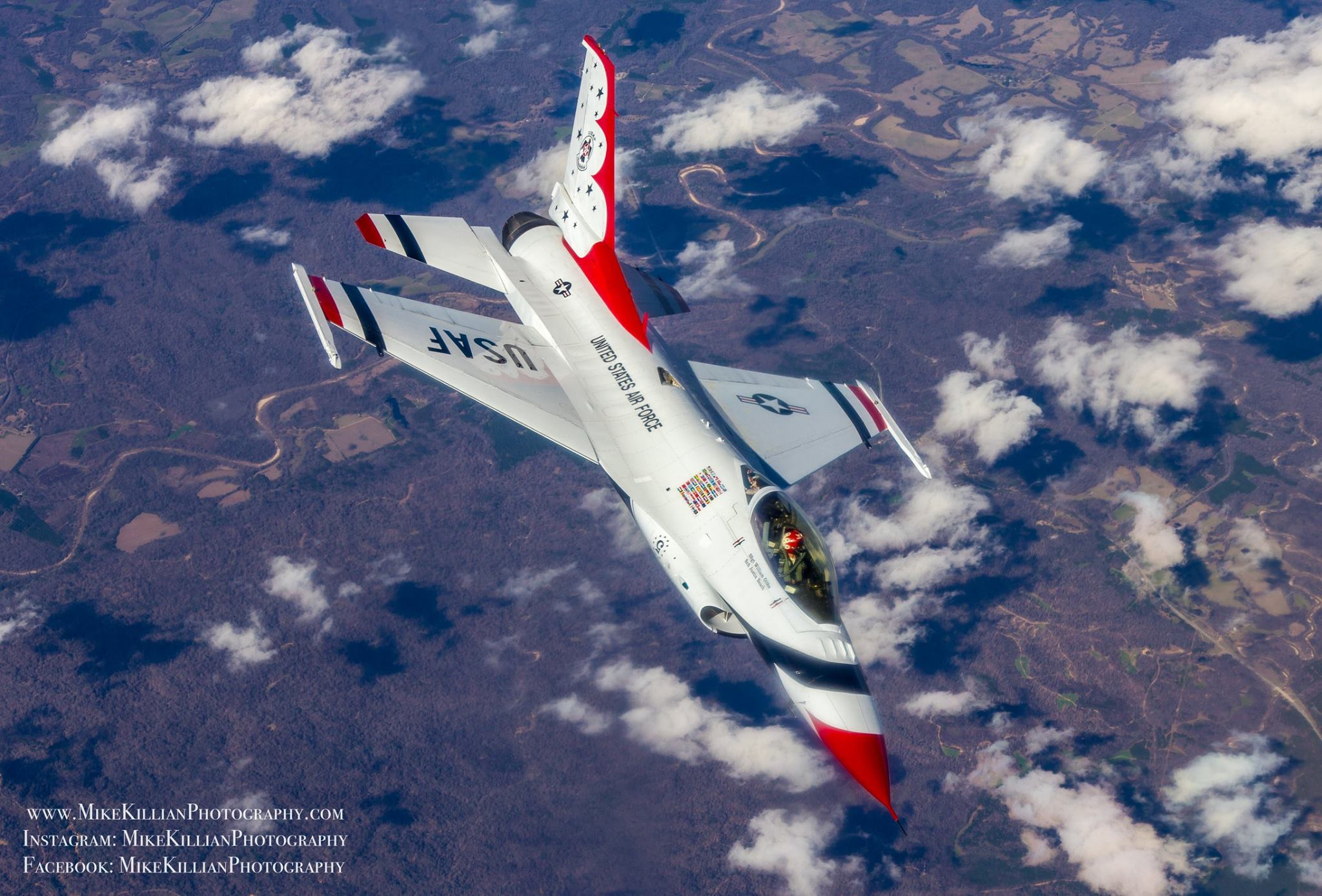 A red, white, and blue F-16 Fighting Falcon rolls out of a pitch following an aerial refueling from a KC-135 tanker. Photo courtesy of Mike Killian.
