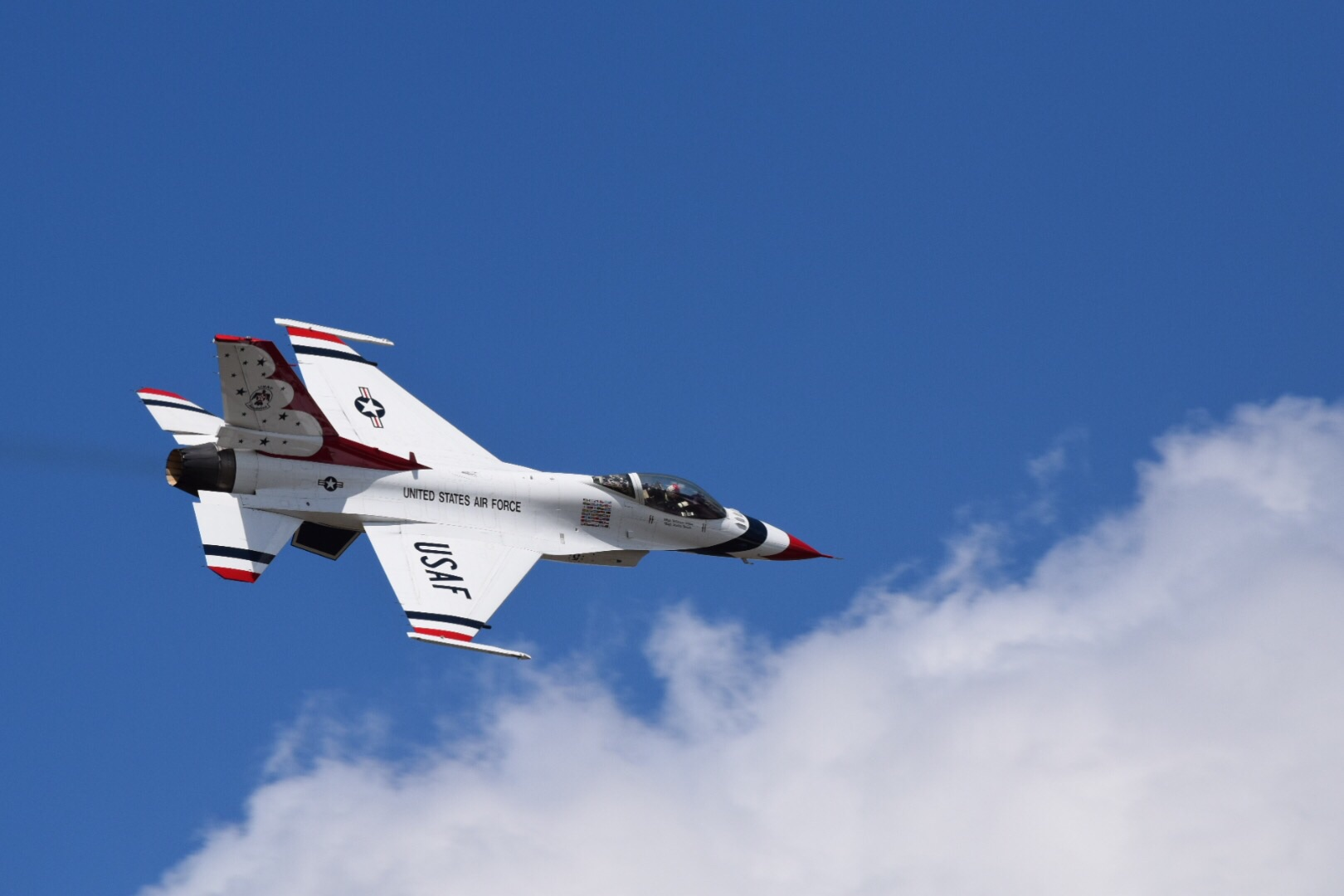 A United States Air Force Thunderbird soars over Lake City on Thursday during a site survey.
