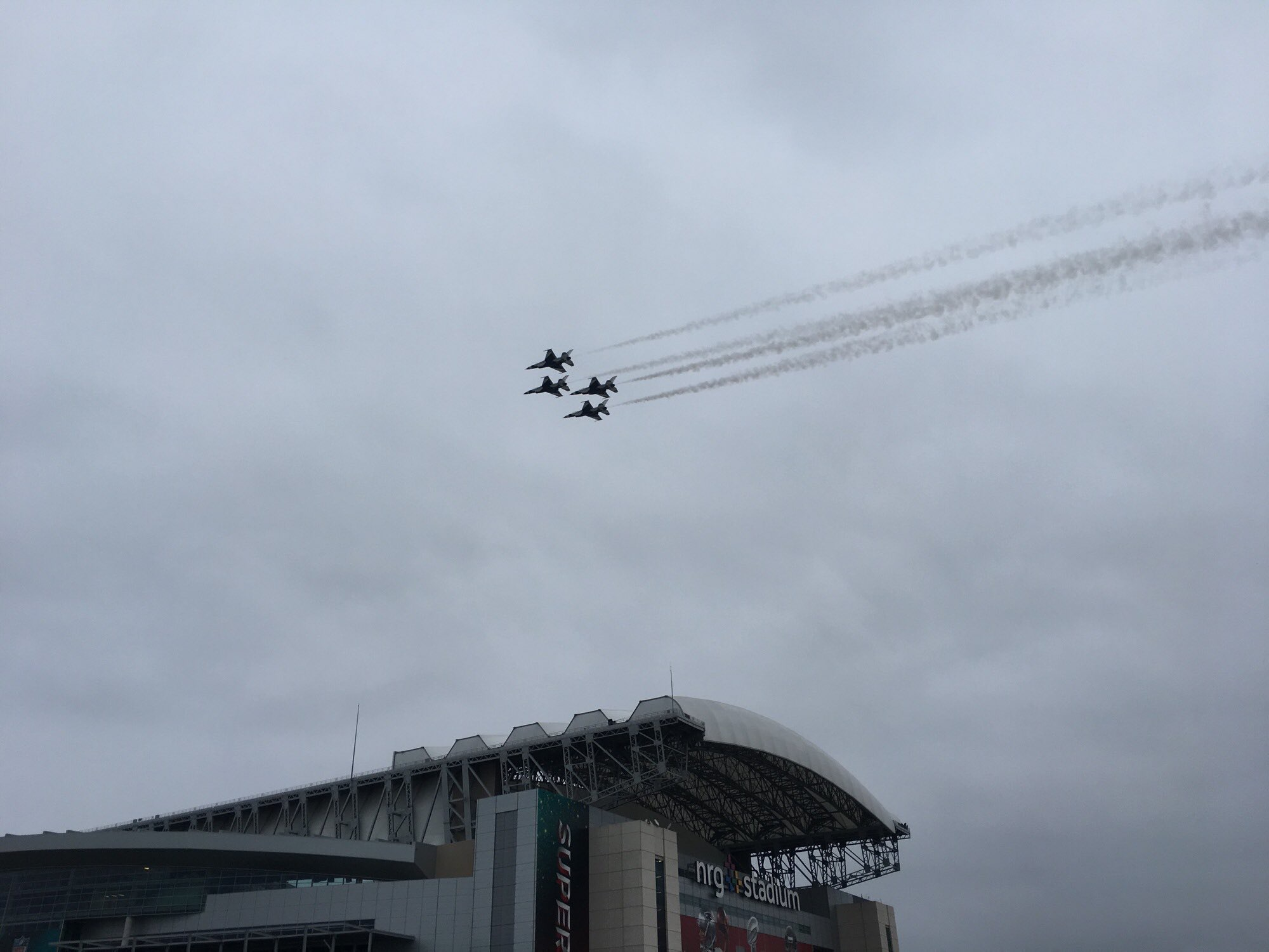 The Thunderbirds perform a practice flyover above NRG Stadium Saturday.  Photo: Phil Lipof