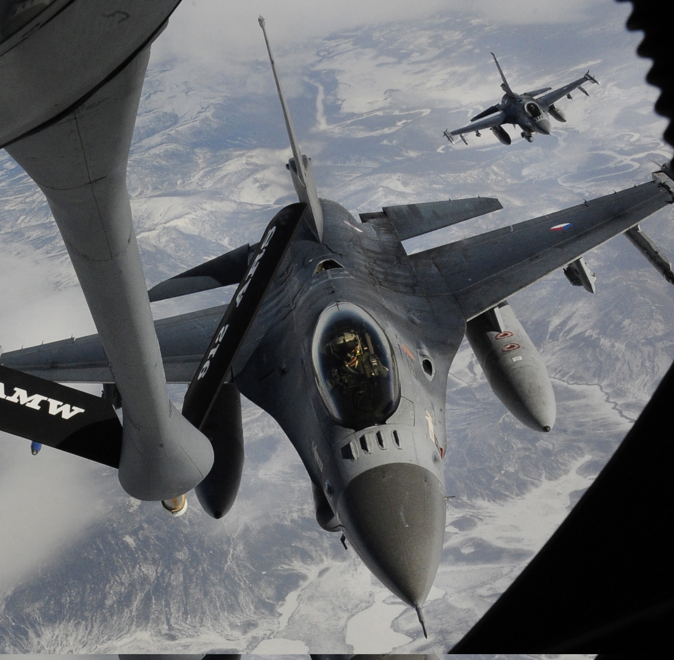 An F-16 receives fuel from a KC-135 Stratotanker.