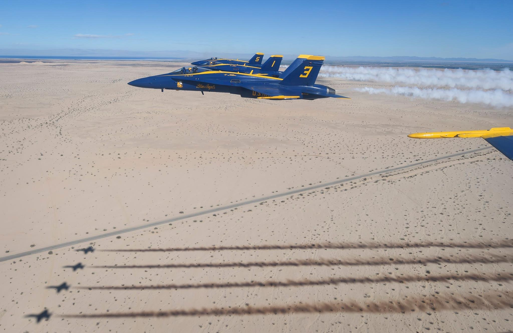 The Blue Angels conduct a winter training flight above the Imperial Valley.