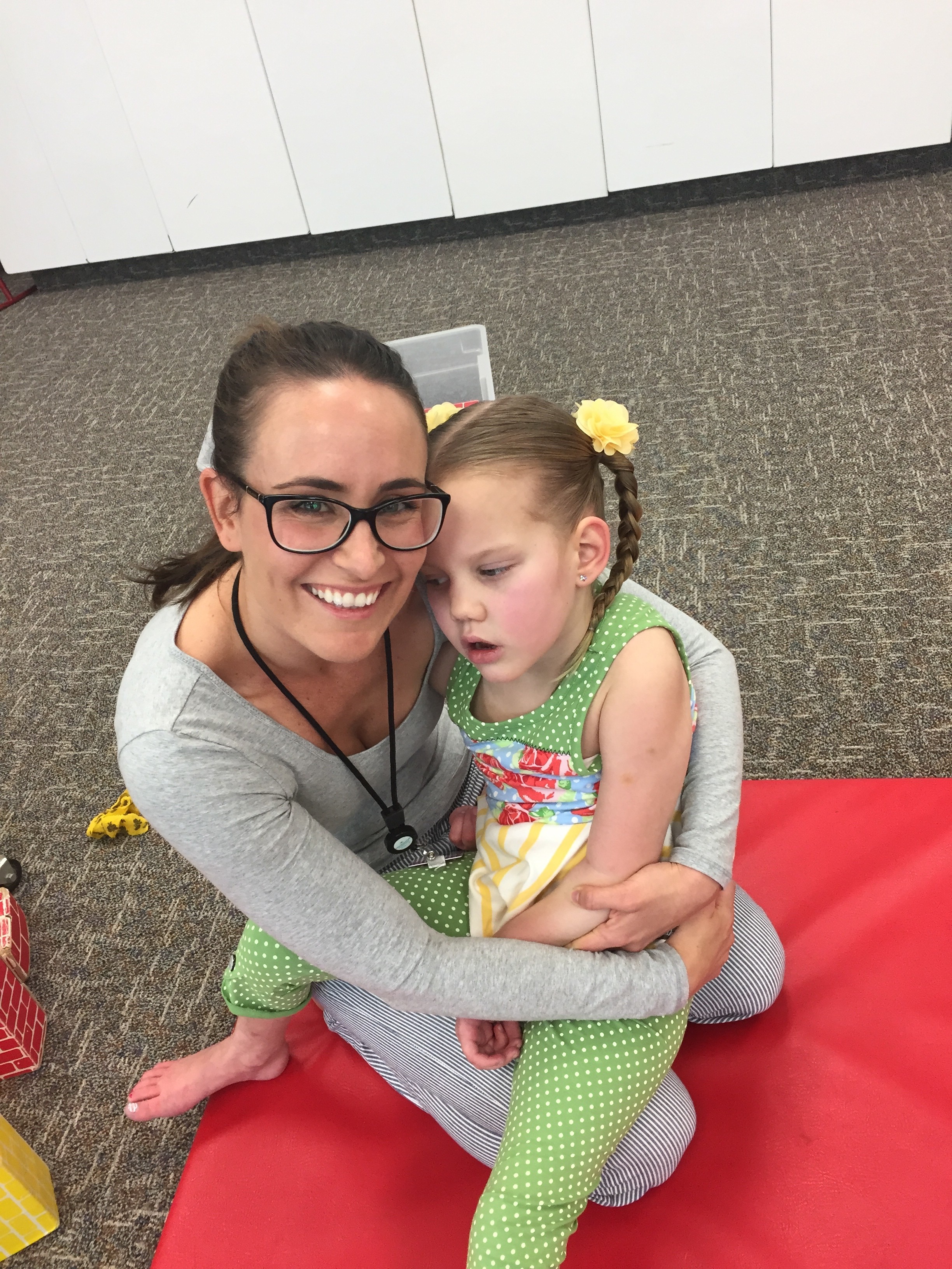 We didn't get a picture with all the therapists, but was happy to see this picture of Kycie and one of her Physical Therapist Amie.  She usually worked weekends with Kycie when dad was at the hospital.  She always pushed Kycie to improve with love and determination.