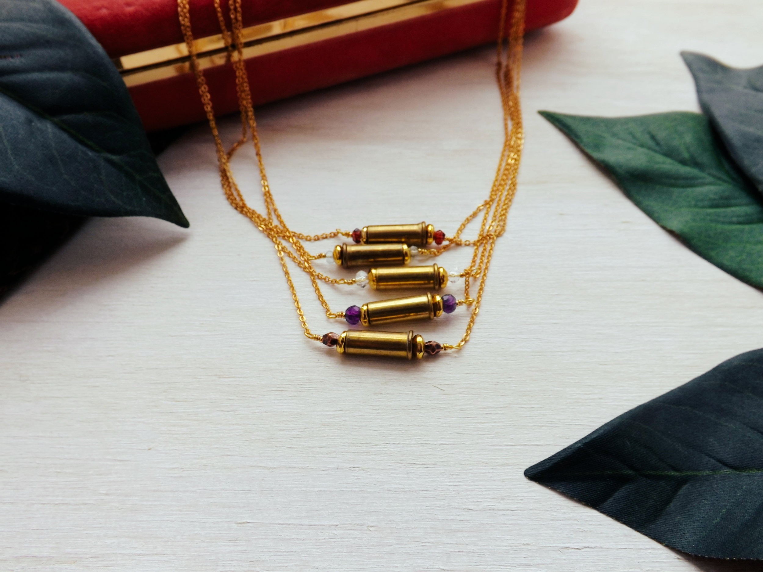Click here for a closer look at our Fiercely Loved dainty bullet shell necklace ($32).