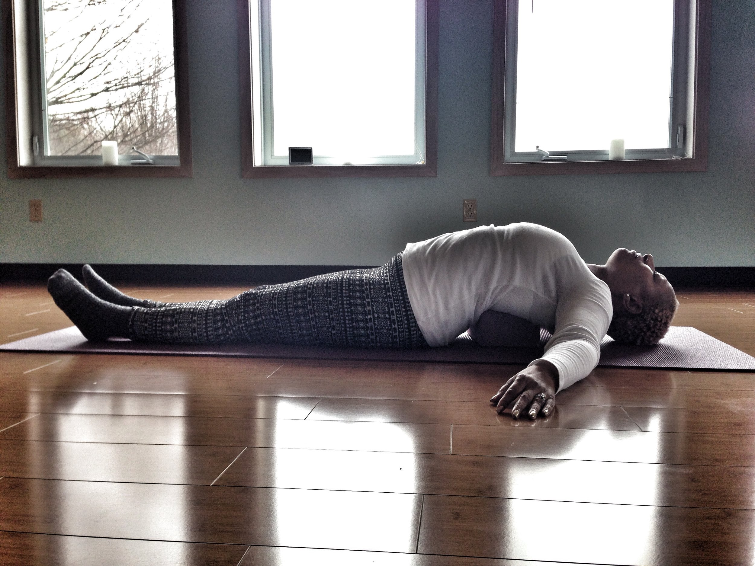 Here is Tanya doing one of her favorite poses, Supported Fish. A wonderful and soothing passive heart-opening posture. Perfect after a long afternoon crocheting or a day in hunched over a computer screen.