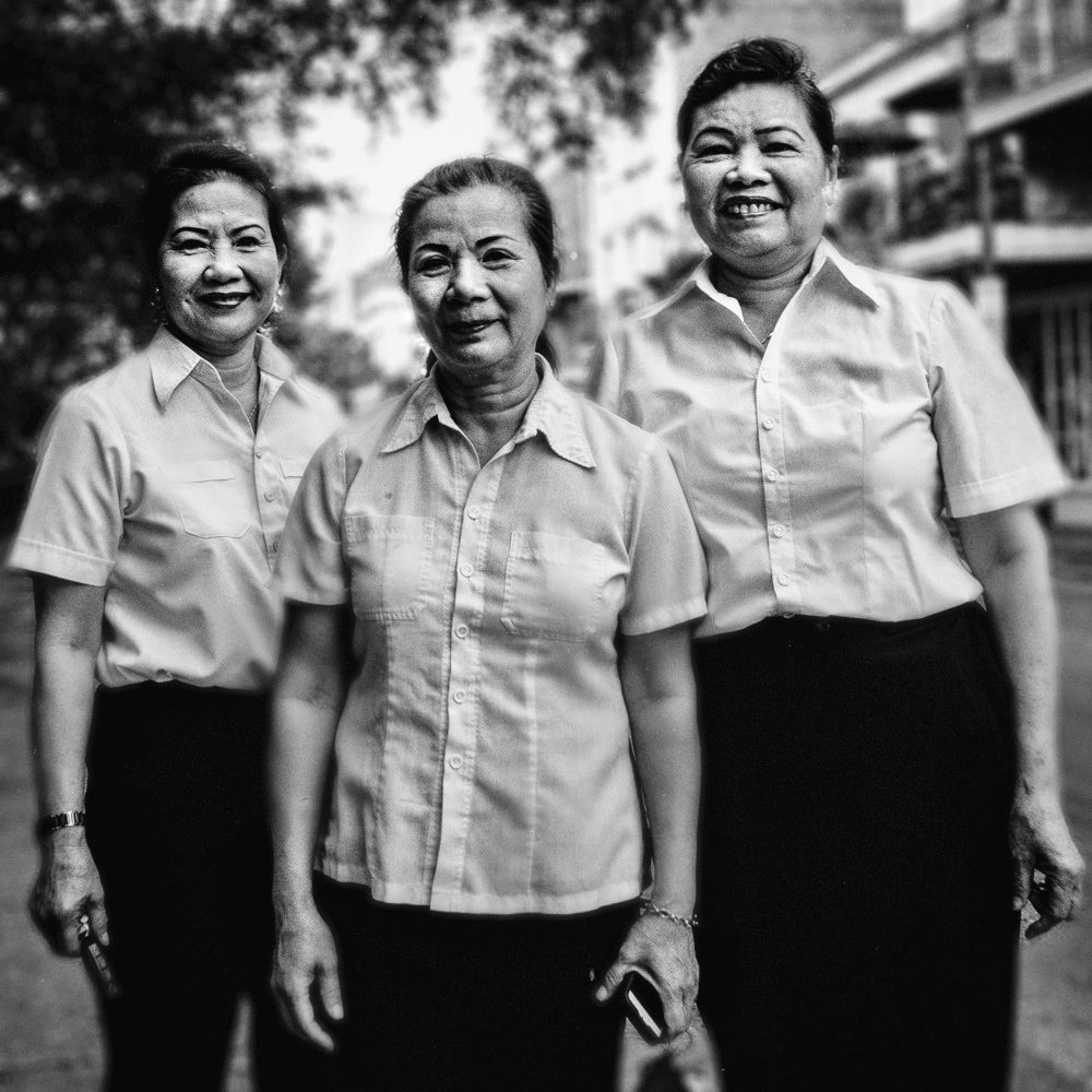 These Women  Virtually every morning I encounter these women on their way to work at Café du Monde, and I try to grab a shot of them at least annually. This picture was this morning. Always walking ( They are my friends June 2016.jpeg