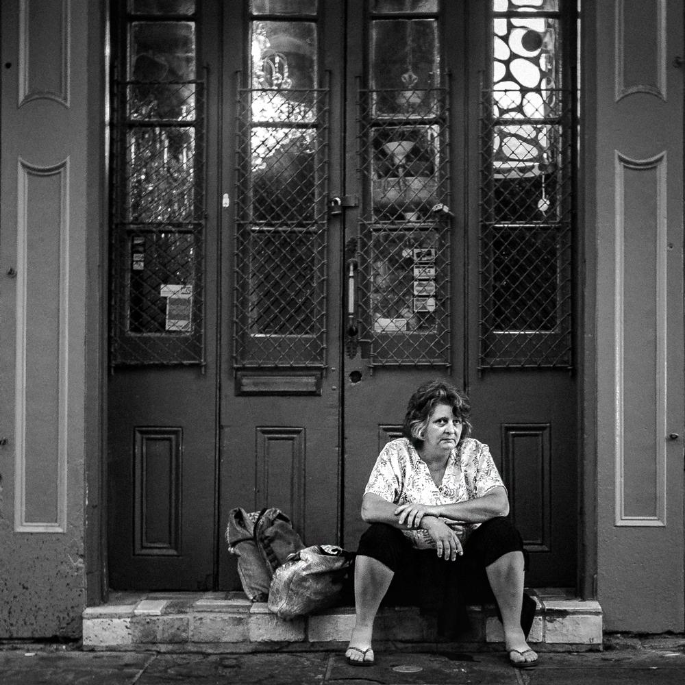 Woman-Sitting-In-Royal-Street-Doorway-BW-21AUG2015-WEB-DSC01516.jpg